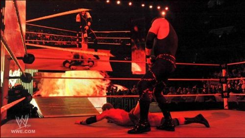Kane-dragging-zack-ryder-560x315